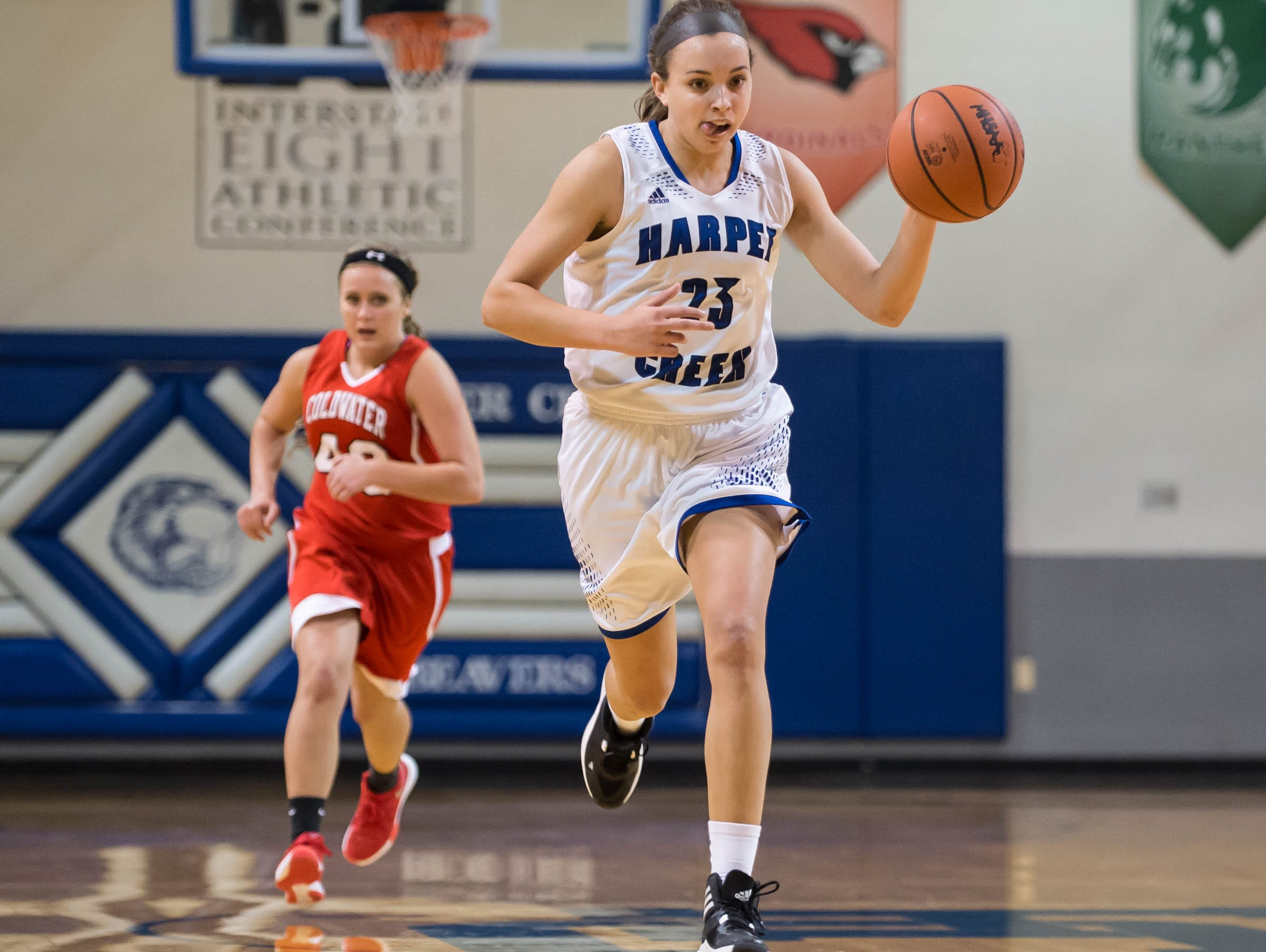 Harper Creek's Charley Andrews drives down the court against Coldwater in Friday evening's game.