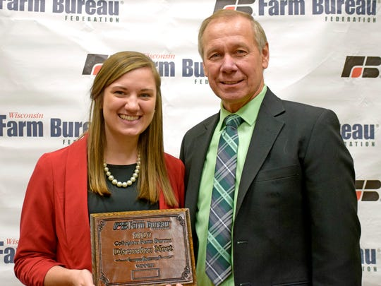 Alison Wedig was selected the winner of the Wisconsin Farm Bureau Federation's Collegiate Discussion Meet contest at the organization's 98th Annual Meeting in Wisconsin Dells on Dec. 3. She is pictured with Farm Bureau President Jim Holte.