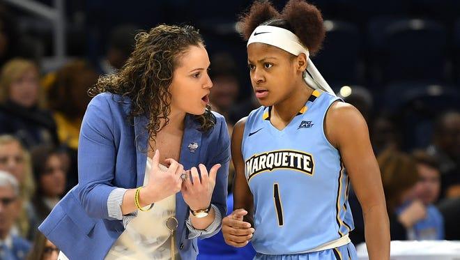 Marquette coach Carolyn Kieger talks with guard Danielle King.