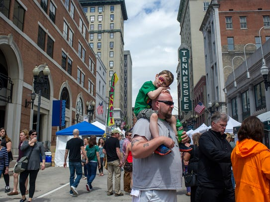 Jordan Harper, 5, rests on his father, Jeremy Harper's, head during the Rossini Festival on Gay Street in Knoxville on April 24, 2015. The event spread across 14 city blocks providing food and entertainment for people of all ages.