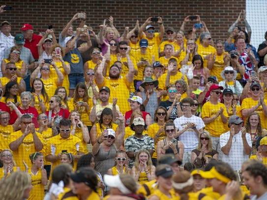 Speedway High School fans celebrate their victory after