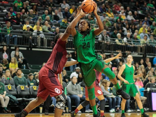Oregon's Ruthy Hebard gets to the basket past Oklahoma's Vionise Pierre-Louis, left, in the second half of an NCAA college basketball game during the Phil Knight Invitational tournament in Eugene, Ore., Saturday, Nov. 25, 2017. (AP Photo/Timothy J. Gonzalez)