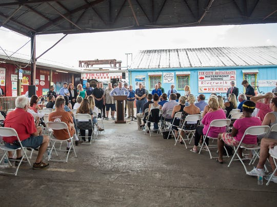Residents gathered at a ribbon-cutting that reopened business at Tin City in Naples on Monday, Oct. 9, 2017, after damage caused by Hurricane Irma.