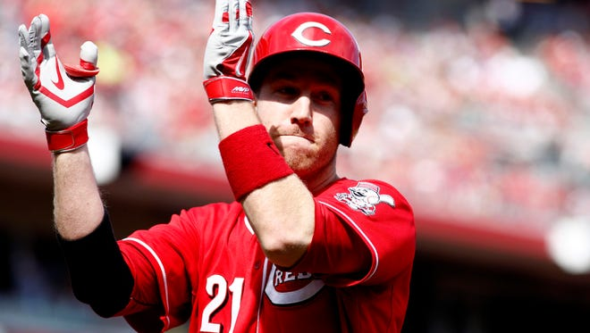 Cincinnati Reds third baseman Todd Frazier reacts after hitting a solo home run off Philadelphia Phillies starting pitcher Roberto Hernandez (not pictured) during the second inning at Great American Ball Park.