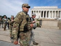 Members of the National Guard walk to their designated positions at the National Mall near the Lincoln Memorial, in Washington on June 3.