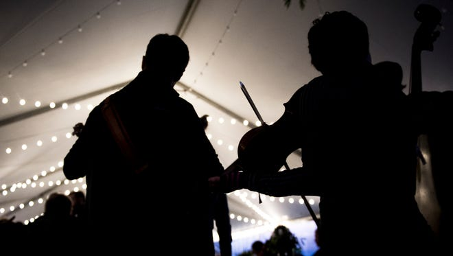 Fiddlers play together during the Fiddlers Convention held at The Mill & Mine as part of Big Ears Festival in downtown Knoxville on Saturday, March 24, 2018.