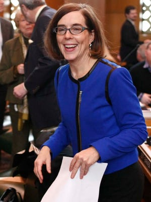 Secretary of State Kate Brown smiles before a swearing-in ceremony Jan. 4, 2013, at the Oregon State Capitol in Salem, Ore.