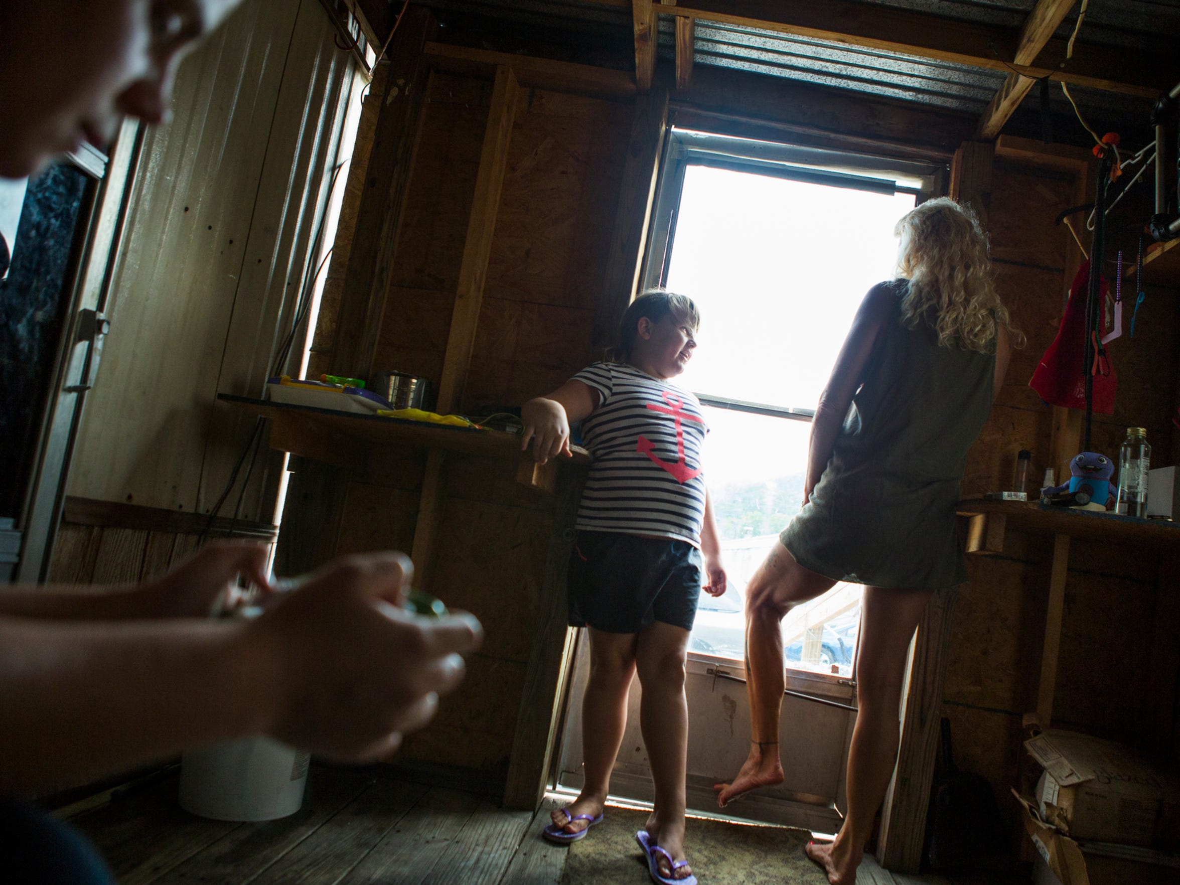 Haley Johnson, 7, and her mom Lisa Smith stand at the
