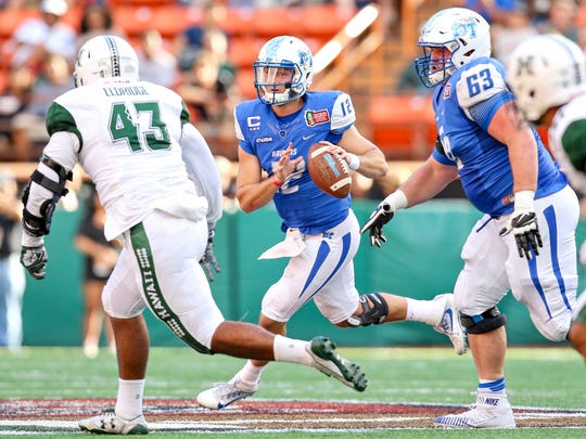 Quarterback Brent Stockstill (12) threw for more than 3,000 yards this year and became MTSU's all-time leader in touchdown passes.