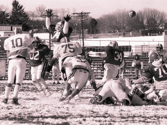 York County quarterback Doug Copp, from Susquehannock, attempts to complete a pass at the first War of the Roses All-Star football game in 1989.