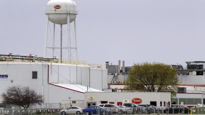 The Tyson Foods pork processing plant is shown April 16 in Columbus Junction. One of the first coronavirus outbreaks at the Iowa meatpacking plant was more severe than previously known, with over twice as many workers becoming infected than the Iowa Department of Public Health publicly confirmed.  The department announced at a May 5 news conference that 221 employees at the plant in Columbus Junction had tested positive for COVID-19. But records show that, days earlier, Tyson officials told workplace safety regulators that 522 plant employees had tested positive to their knowledge.