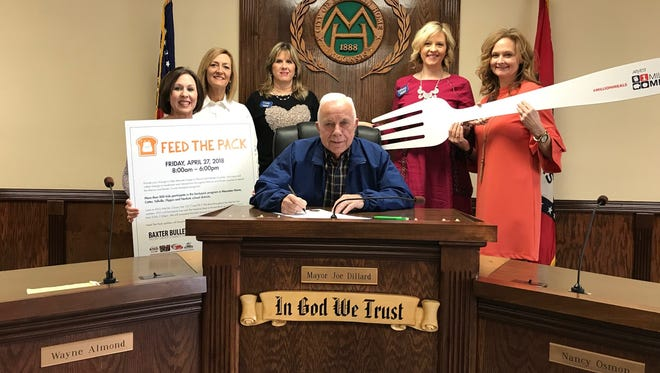 Representatives from Arvest Bank in Mountain Home join Mayor Joe Dillard as he signs a proclamation to designate April 27, 2018 as Feed the Pack Day in Mountain Home.  Feed the Pack is a one-day donation drive and grassroots effort by Arvest Bank to help reduce food security in communities.