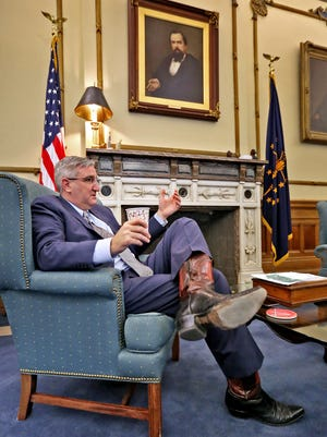Governor Eric  Holcomb talks about his year as Governor, speaking from his office at the Statehouse, Thursday, Dec. 7, 2017.
