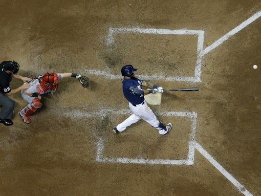 Milwaukee Brewers' Eric Thames hits a two-run home run during the sixth inning of a baseball game against the Cincinnati Reds Tuesday, April 25, 2017, in Milwaukee. (AP Photo/Morry Gash)