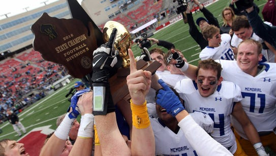 Catholic Memorial players celebrate with the championship