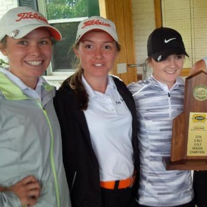 The Ryle girls with the Region 6 championship trophy.