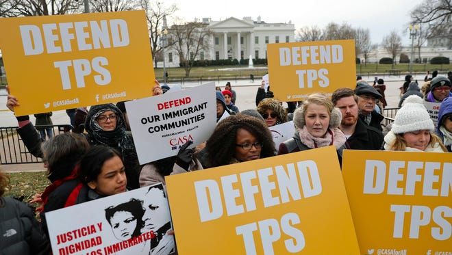Immigration advocates rally near the White House in Washington, D.C., on Jan. 8, 2018, to support Temporary Protected Status for foreigners living in the U.S.