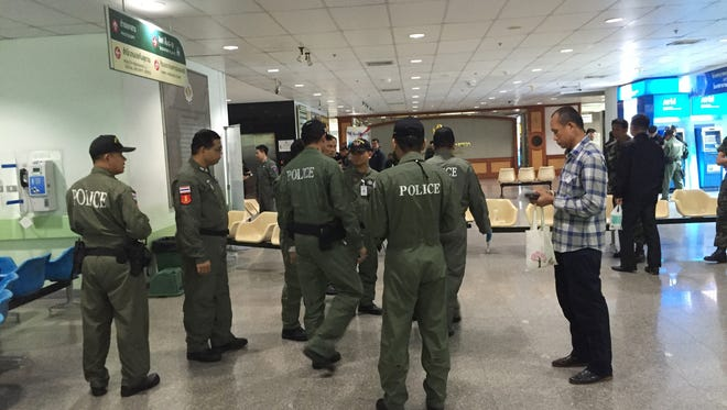 Police investigators work at the lobby of Phramongkutklao Hospital, a military-owned hospital that is also open to civilians, in Bangkok after a bomb wounded more than 20 people, Monday, May 22, 2017.