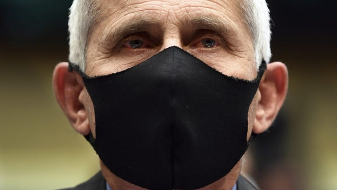 FILE - Director of the National Institute of Allergy and Infectious Diseases Dr. Anthony Fauci wears a face mask as he waits to testify before a House Committee on Energy and Commerce on the Trump administration's response to the COVID-19 pandemic on Capitol Hill in Washington on Tuesday, June 23, 2020.