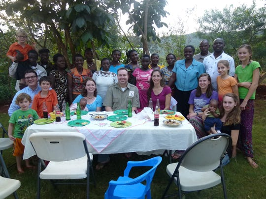 Calvin and Alicia Groen and their three girls are back after doing mission work in Tanzania in Africa. The couple build an orphanage in Geita, Tanzania. This is a photograph of the entire staff at Neema House orphanage.