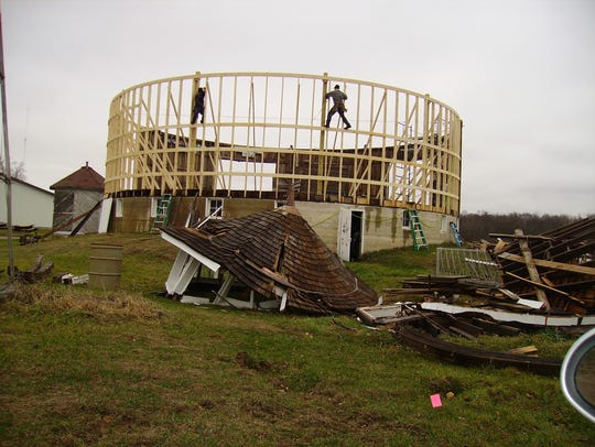 A crew works to restore the Fulton County Historical