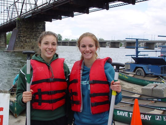 Rebekah Finafrock (left) and Abby Hebenton pose at the Chesapeake Bay Foundation's Canoe Classic.