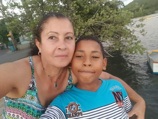 Maria Pacheco Albino, 59, appears with Omar Jr., 9.