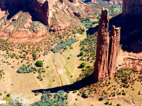 Spider Rock is Canyon de Chelly's most famous formation is a breathtaking spire soaring 800 feet from the canyon floor.
