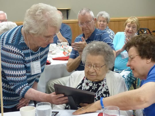 Lois Brundidge presents a plaque to Balbina Presl of the Class of 1935 during the 2016 YesterYears reunion of Wausau High School.
