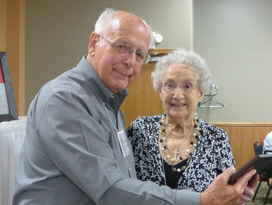 Wayne Plant presents a plaque to Ruth Schultz, Wausau