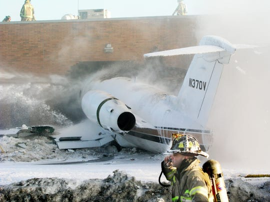 Corporate plane crashes into warehouse.