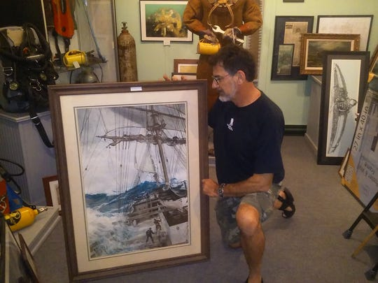 Dan Lieb, director of the Shipwreck Museum at the InfoAge Science Center in Wall, with one the paintings on exhibit the weekend of Nov. 4 and 5.