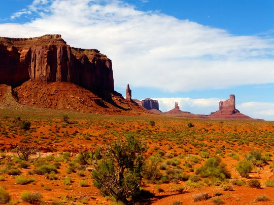 Monument Valley straddles the Arizona-Utah border and is a centerpiece landscape of the Navajo Nation.