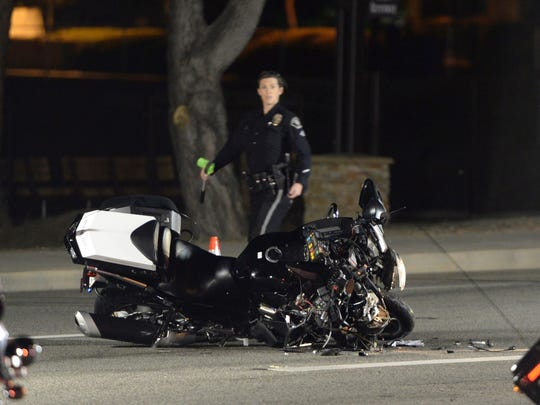 A damaged motorcycle is visible after a crash involving a California Highway Patrol officer who was in Canadian Prime Minister Justin Trudeau's motorcade Friday night in Simi Valley.