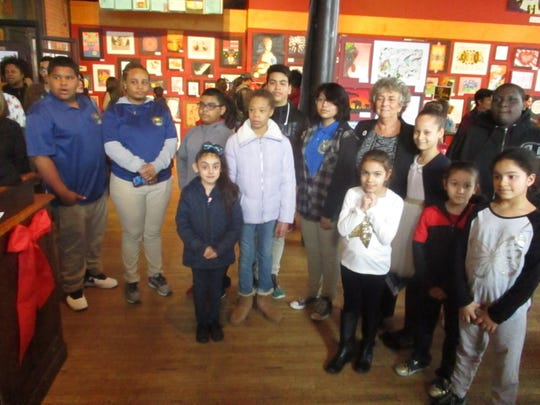 Paterson student artists and family members gather with acting Schools Superintendent Eileen Shafer (rear row, third from right) at a recent reception at the Paterson Museum.