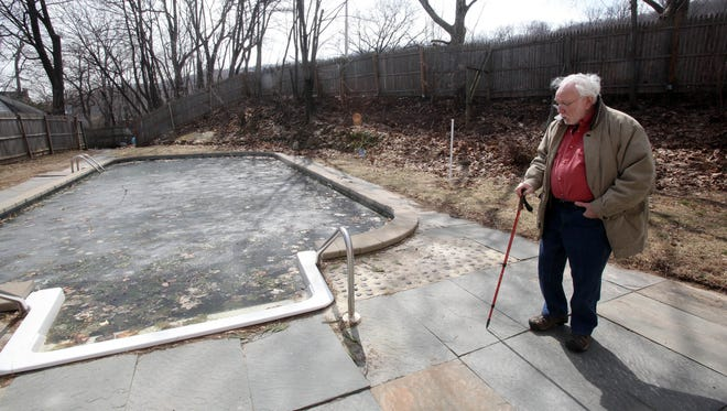 Robert Wisner in the backyard of his Cornelison Avenue home in South Nyack, a sizable portion of which had been purchased by the state through eminent domain proceedings. The state Thruway Authority's recently decided not to connect a bike path there, meaning the land will return to Wisner and he can keep his swimming pool.