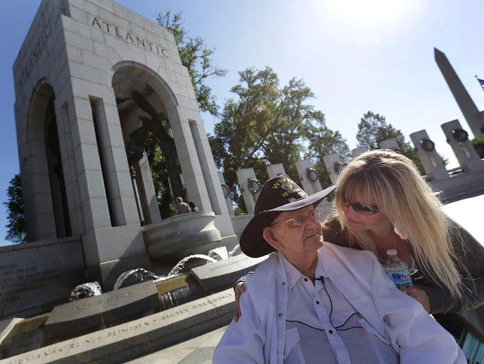 WWII veteran Fred Plichta, 88, talks with Regina Johnson
