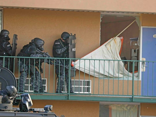 The Clarksville Police Tactical Unit responds to a barricaded subject in a motel room. The tactical unit is one of many that would become part of the sheriff's office under consolidated government.