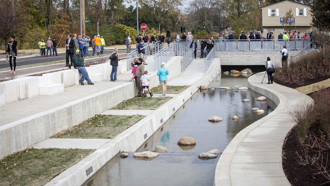 Dozens of community members and city workers came to the Liberty Pass canal dedication earlier this year. The canal is a decorative feature for the project to move stormwater from downtown.