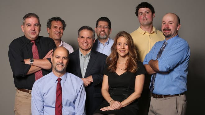 From left: Jorge Fitz-Gibbon, Frank Scandale (seated), David McKay Wilson, Thomas Zambito, Jonathan Bandler, Adrienne Sanders, Lee Higgins and David Robinson at the Watchdog Team at The Journal News and lohud.com.