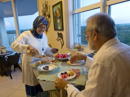 Shahina and Victor Begg prepare to break their fast during Ramadan on  July 24, 2014.