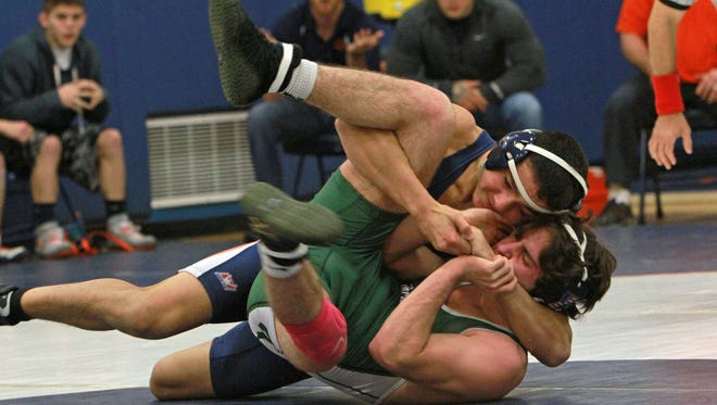From left, Greeley's Aaron Wolk on his way to pinning Yorktown's Ross Mandel in the 145-pound weight class during wrestling action at Horace Greeley High School in Chappaqua Jan. 6, 2016.