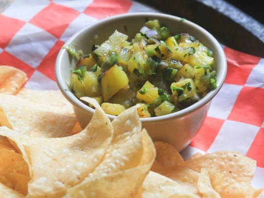 Pineapple salsa from Manny & Merle on West Main Street in downtown Louisville.  Feb. 22, 2016