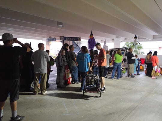 Families enjoy Mesquite Police Department's Trunk-or-Treat at the CasaBlanca Resort and Casino parking garage Halloween night.
