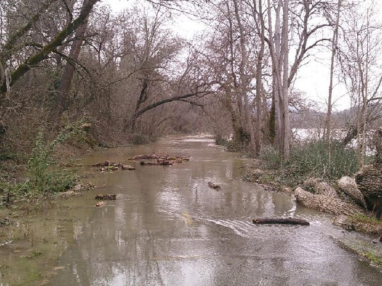 On Wednesday, as the flows in the Sacramento River reached 79,000 cubic feet per second, the river flooded the Sacramento River Trail in Redding.