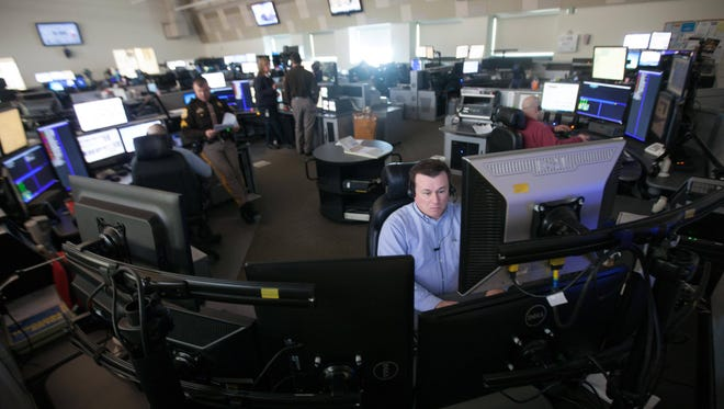 Fred Hedrick, telecommunicator for the New Castle County police department, fields emergency calls in the 911 call center at the Cpl. Paul J. Sweeney Public Safety Building in New Castle on Wednesday.