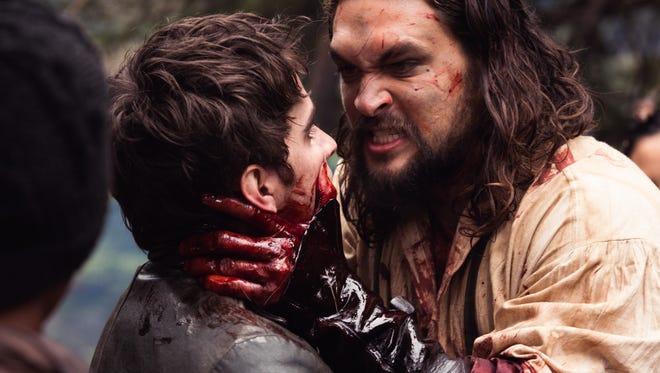 "Michael Smyth (Landon Liboiron) and Declan Harp (Jason Momoa) clash in ""Frontier."""