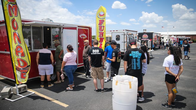People wait in line to get food during the Food Truck Festival Saturday, June 9, 2018, at  Lake View Bible Church.