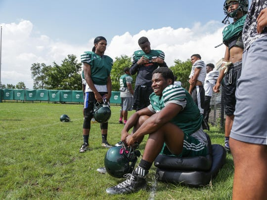 Detroit Cass Tech varsity football qb Rodney Hall sits while watching practice with teammates on Wednesday August 17, 2016 at Cass Tech High School in Detroit.