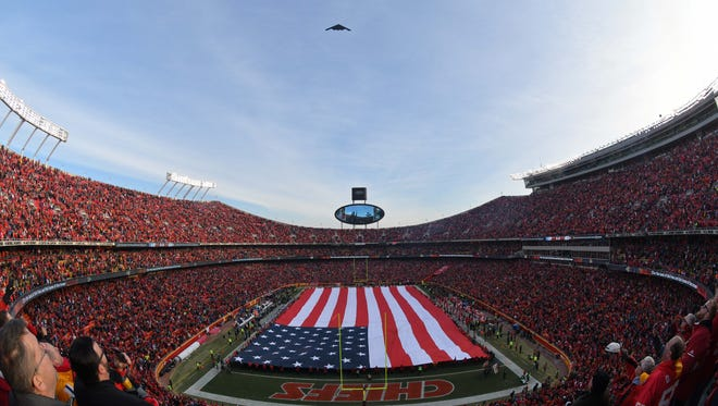 A B-2 stealth bomber performs a flyover during the national anthem before the AFC Wild Card playoff football game between the Kansas City Chiefs and the Tennessee Titans at Arrowhead Stadium.